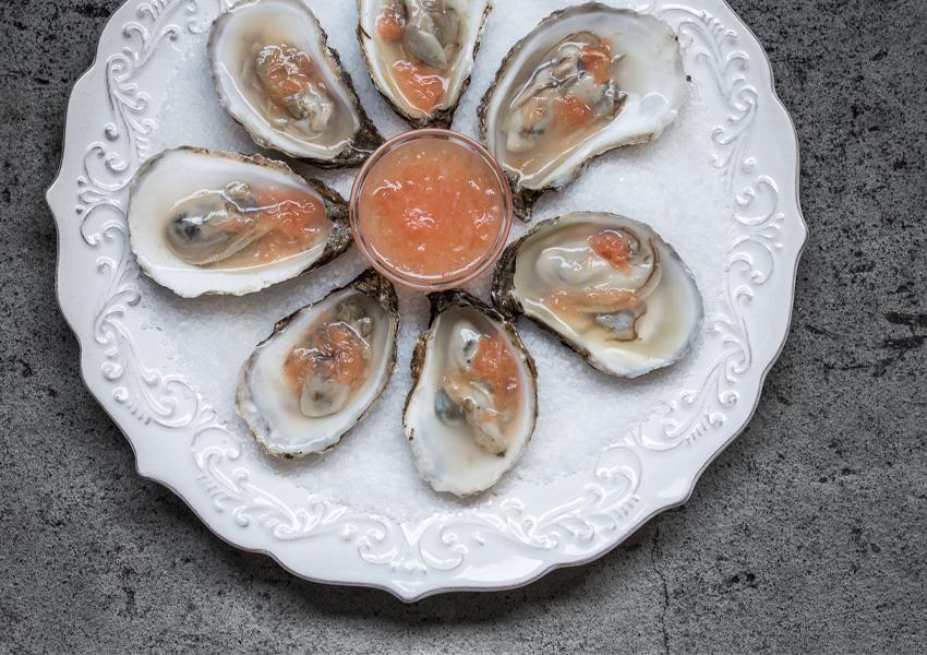 Huîtres, sauce wasabi et pamplemousse rose